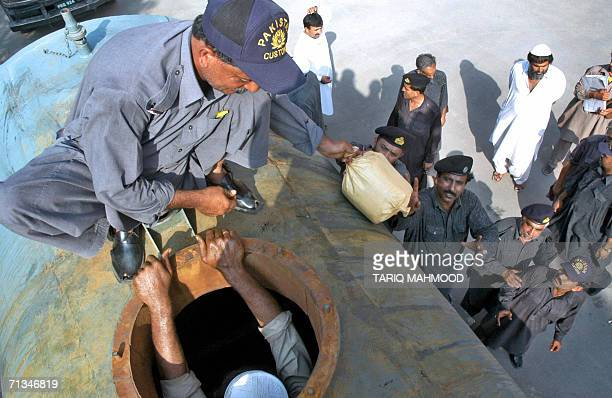 Pakistani custom officials unload bags of seized hashish drugs after recovery from an oil tanker in Peshawar 01 July 2006 Pakistani customs seized...