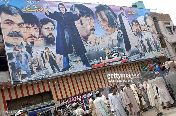 Pakistani pedestrians gather outside a cinema hall in Peshawar 22 September 2006 A lawmaker from a hardline Islamic alliance ruling Pakistan's...