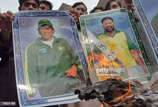 Pakistani protesters set fire to the posters of cricket team captain InzamamulHaq and cricketer Younis Khan during a demonstration in Peshawar 18...