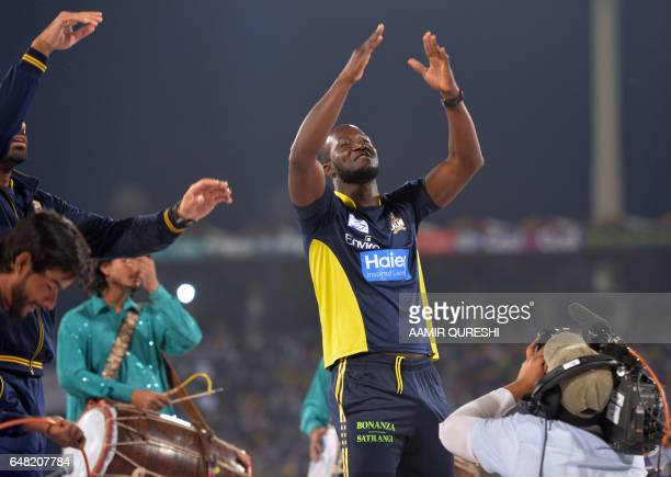 Peshawar Zalmi captain West Indies Darren Sammy dances on a stage prior to the start of the final cricket match of the Pakistan Super League with...