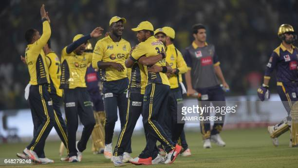 Peshawar Zalmi cricketers celebrate after dismissal of Quetta Gladiators batsman Ahmed Shehzad during the final cricket match of the Pakistan Super...