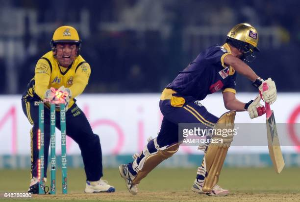 Peshawar Zalmi wicketkeeper Kamran Akmal makes a succussful stump out of Quetta Gladiators batsman Muhammad Nawaz during the final cricket match of...