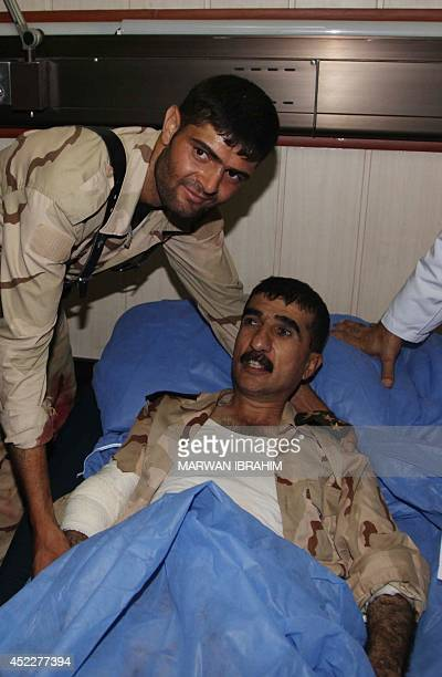 Peshmerga Brigadier General Shirko Rauf lies in a hospital bed on July 17 in Iraq's disputed northern city of Kirkuk Iraqi security forces backed by...