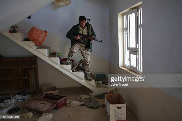 Peshmerga fighter searches a house near the frontline with ISIL on November 16 2015 in Sinjar Iraq Kurdish forces with the aid of massive USled...