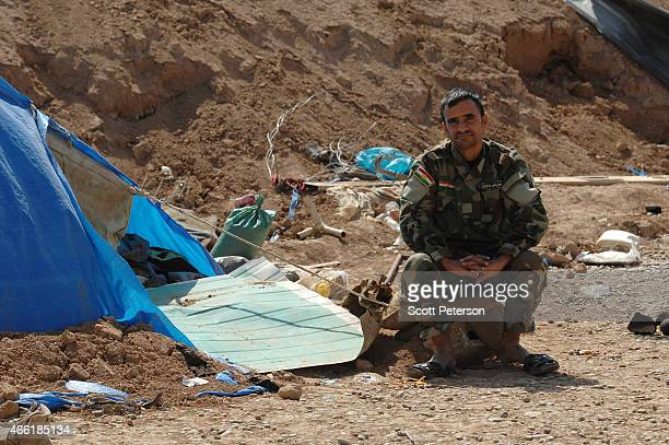 A peshmerga fighter sits beside his tent as Iraqi Kurdish forces push the frontline forward against ISIS forces in the Tal alWard district 20 miles...