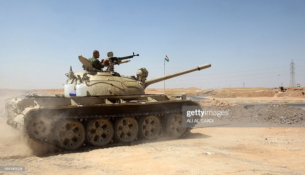 A Peshmerga fighter stands guard in a tank at their post in the strategic Jalawla area, in Diyala province, which is a gateway to Baghdad, as battles with Islamic State (IS) jihadists continue on August 25, 2014. Kurdish forces backed by Iraqi air support retook three villages in the Jalawla area, as well as a main road used by jihadists to transport fighters and supplies, peshmerga members said.