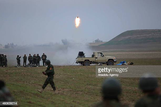 Peshmerga fighters attack Islamic State of Iraq and Levant with missiles during the clashes in Sinun district of Mosul northern Iraq as Peshmerga...