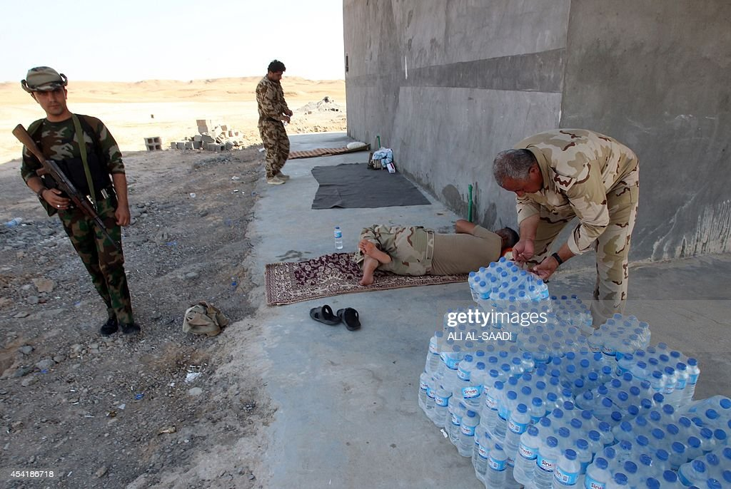 Peshmerga fighters rest at a position near the strategic Jalawla area, in Diyala province, which is a gateway to Baghdad, as battles with Islamic State (IS) jihadists continue on August 25, 2014. Kurdish forces backed by Iraqi air support retook three villages in the Jalawla area, as well as a main road used by jihadists to transport fighters and supplies, peshmerga members said.