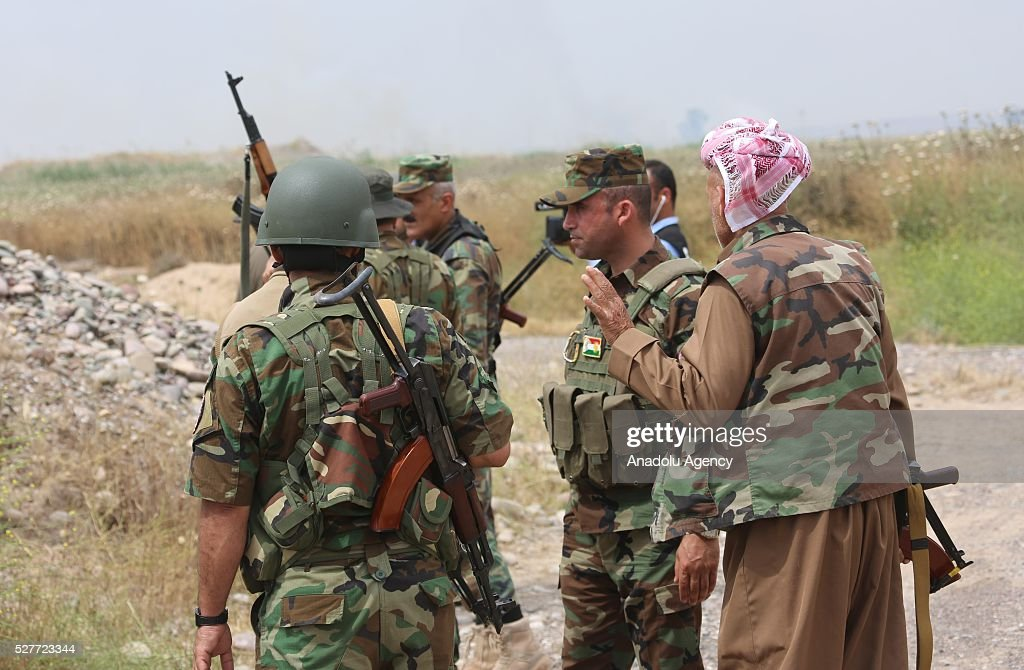 Peshmerga forces are seen during clashes between Daesh and Peshmergas on Guve side of Peshmerga in Mosul's Mahmur district, Iraq on May 3, 2016.