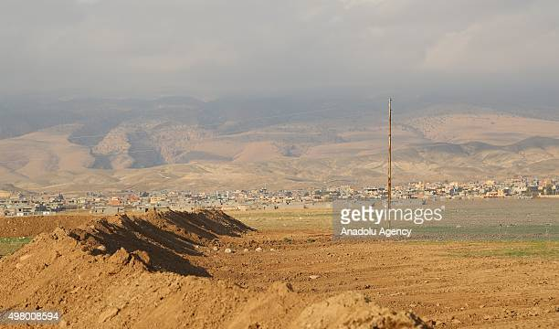 Peshmerga forces belonging to the Kurdish Regional Government excavate ditches along to the 80 kilometers front of Sinjar town in Mosul Iraq on...