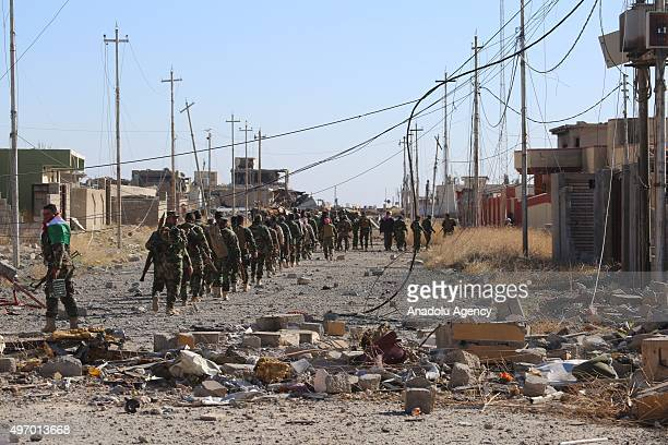 Peshmerga forces belonging to the Kurdish Regional Government are seen as marching at the town center as they fully gained the control of the Sinjar...