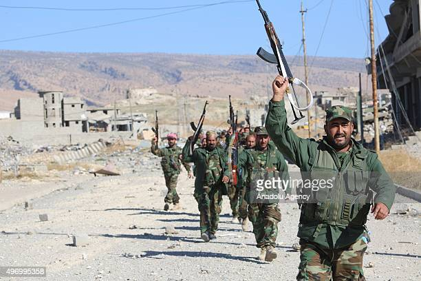 Peshmerga forces belonging to the Kurdish Regional Government celebrate the victory as they fully gained the control of the Sinjar town of Mosul Iraq...