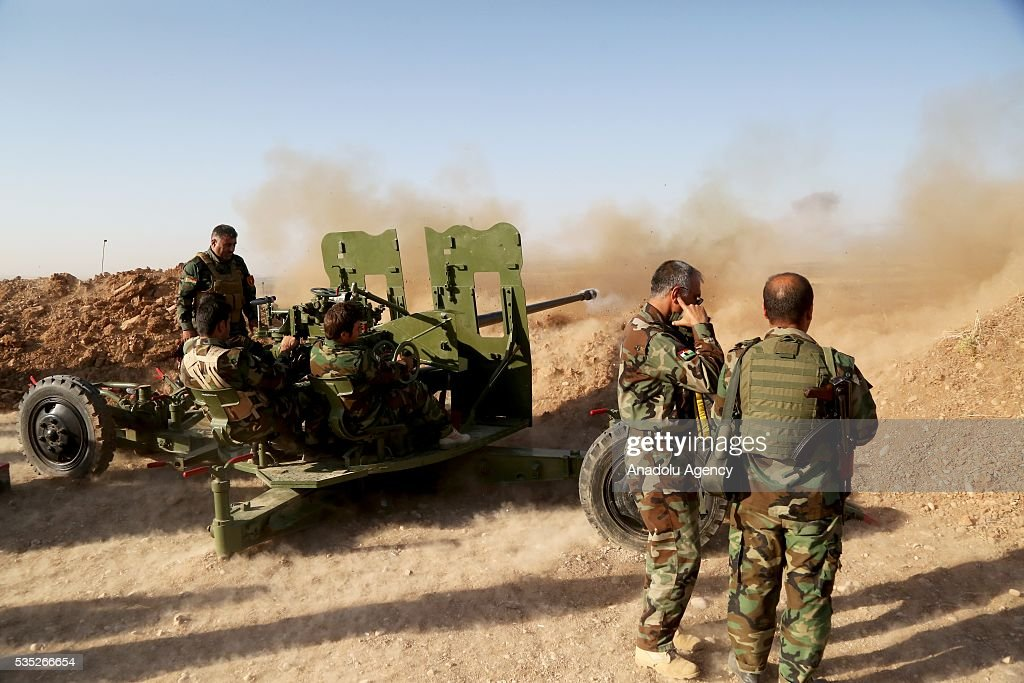 Peshmerga forces fire artillery during an operation against Daesh terrorists in Hazer region Mosul, Iraq on May 29, 2016. Coalition forces support the operation with warcrafts.
