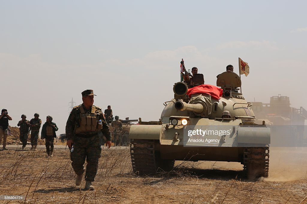 Peshmerga forces' heavily armed vehicles are seen during an operation against Daesh terrorists in Hazer region Mosul, Iraq on May 29, 2016. Coalition forces support the operation with warcrafts.