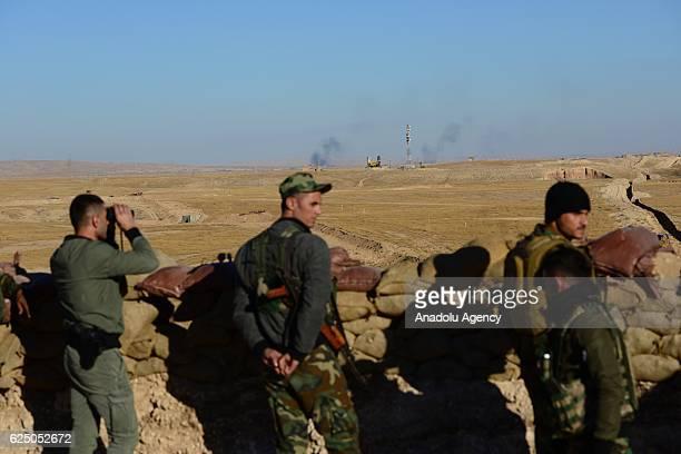 Peshmerga forces in Sinjar town look on as Daesh terrorists run away from the Beac district of Mosul towards Raqqa in Mosul Iraq on November 22 2016...