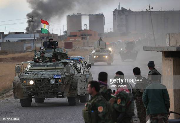 Peshmerga forces patrol on November 15 2015 in Sinjar Iraq Kurdish forces with the aid of massive USled coalition airstrikes liberated the town from...