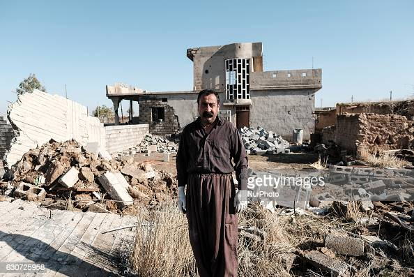 Peshmerga named Imad Diab infront of rubble of his destroyed house in Tel Laban/ Gazakan on 30 December 2016 The Kakai Kurds are returning to their...