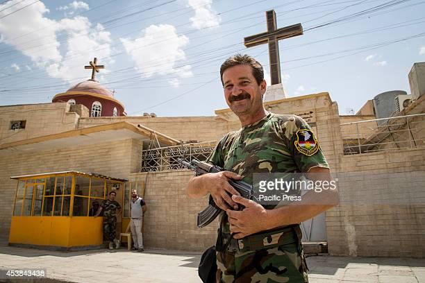 Peshmerga stands watch in front of a church Qaraqosh Iraq