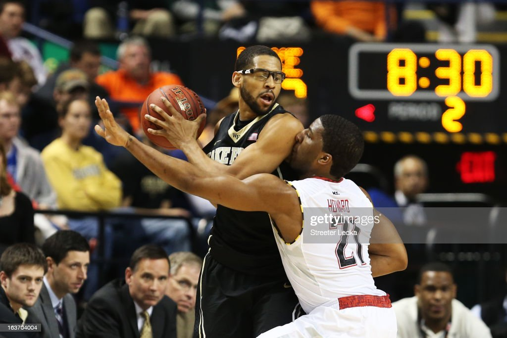 Pe'Shon Howard #21 of the Maryland Terrapins defends against C.J. Harris #11 of the Wake Forest Demon Deacons in the second half of their game during the first round of the Men's ACC Basketball Tournament at Greensboro Coliseum on March 14, 2013 in Greensboro, North Carolina.