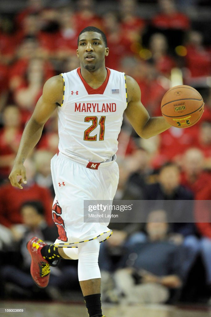 Pe'Shon Howard #21 of the Maryland Terrapins dribbles up court during a college basketball game against the Florida State Seminoles on January 9, 2013 at the Comcast Center in College Park, Maryland. The Seminoles won 65-62.