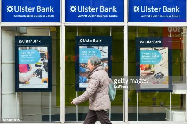A peson is passing in front of Ulster Bank branch in Dublin's city center Ulster Bank Chief Executive Gerry Mallon announced that Ulster Bank to...
