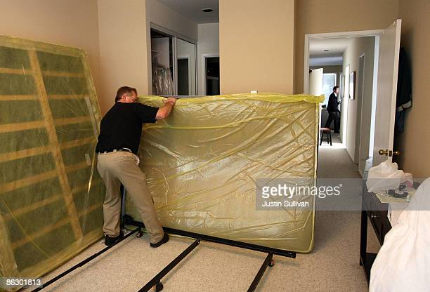 Pestec technician Darrell Azlin moves a bed as he preapares to use a heat treatment at an apartment with bed bugs April 30 2009 in San Francisco...