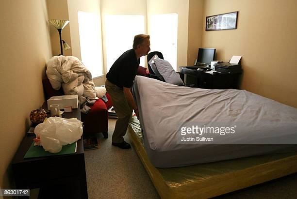 Pestec technician Darrell Azlin moves a bed in an apartment with bed bugs April 30 2009 in San Francisco California Cases of bed bug infestations are...