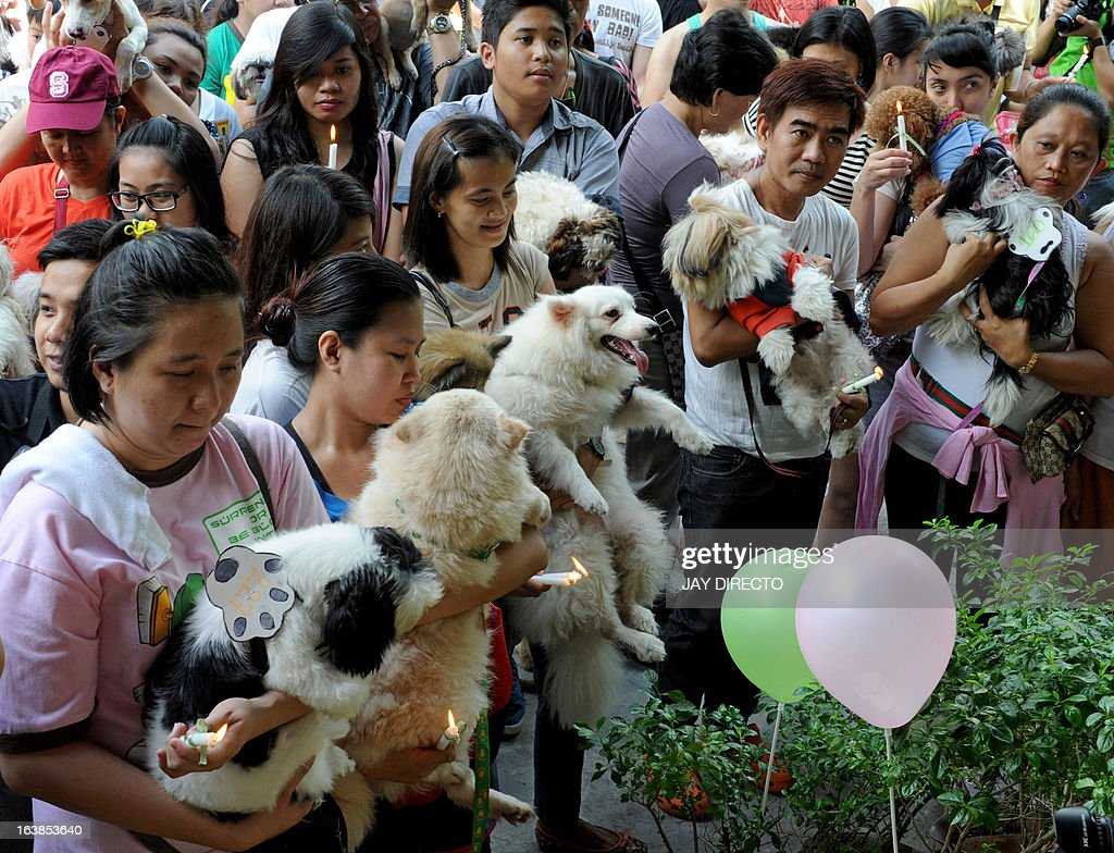 Pet owners queue to have a Catholic priest bless their pet dogs and cats during an event in Manila on March 17, 2013. A local government is offering free veterinary services and free vaccinations against rabies as the Department of Health designated March as Rabies Awareness Month as part of its national rabies prevention and control program, with the aid of eliminating the disease from the Philippines by 2020.