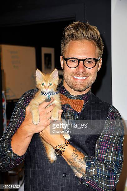 Pet photographer and author Seth Casteel attends Rachael Ray gives shelter cats makeovers to help launch the 'Shelter Cats Are Beautiful' campaign at...