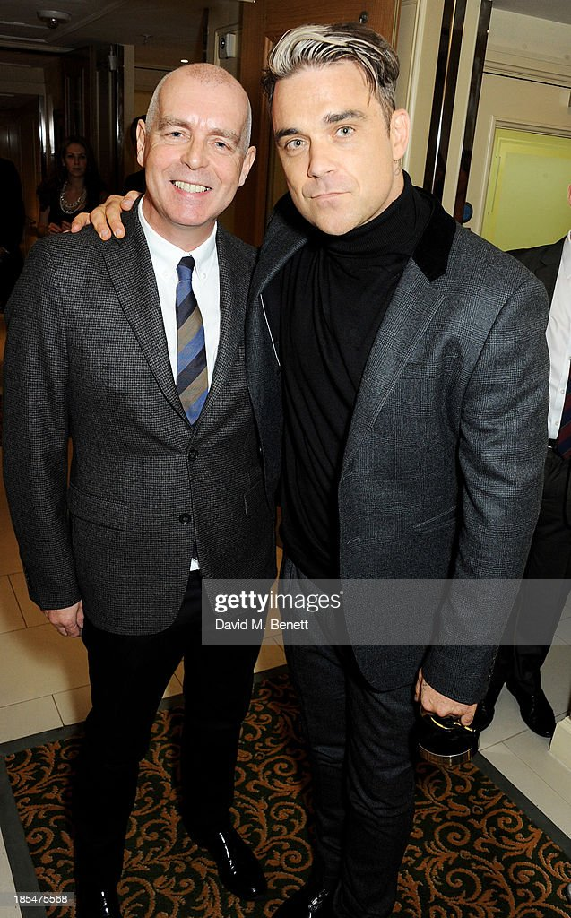 Pet Shop Boy <a gi-track='captionPersonalityLinkClicked' href=/galleries/search?phrase=Neil+Tennant&family=editorial&specificpeople=213865 ng-click='$event.stopPropagation()'>Neil Tennant</a> (L) and Q Idol winner <a gi-track='captionPersonalityLinkClicked' href=/galleries/search?phrase=Robbie+Williams&family=editorial&specificpeople=201201 ng-click='$event.stopPropagation()'>Robbie Williams</a> pose in the press room at The Q Awards at The Grosvenor House Hotel on October 21, 2013 in London, England.