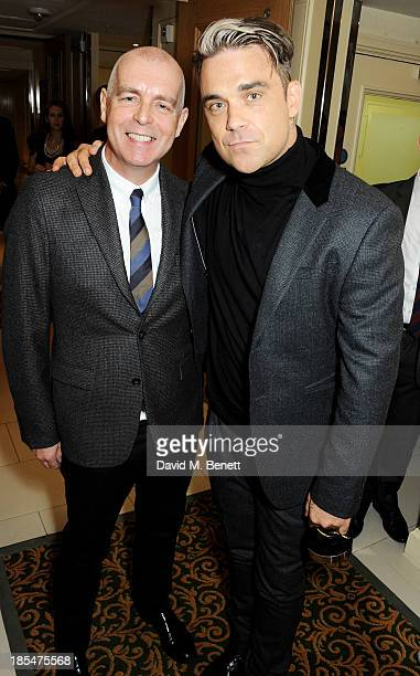 Pet Shop Boy Neil Tennant and Q Idol winner Robbie Williams pose in the press room at The Q Awards at The Grosvenor House Hotel on October 21 2013 in...