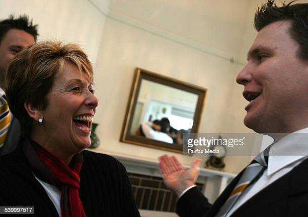 Peta Champion shares her joy with auctioneer Peter Matthews after the auction of her Burnell Street Drummoyne 15 July 2006 SHD Picture by JANIE...