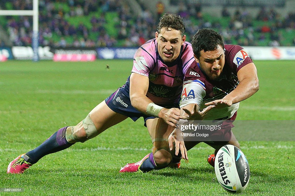 Peta Hiku (R) of the Eagles scores a try against <a gi-track='captionPersonalityLinkClicked' href=/galleries/search?phrase=Billy+Slater&family=editorial&specificpeople=171206 ng-click='$event.stopPropagation()'>Billy Slater</a> of the Storm during the round nine NRL match between the Melbourne Storm and the Manly-Warringah Sea Eagles at AAMI Park on May 10, 2014 in Melbourne, Australia.