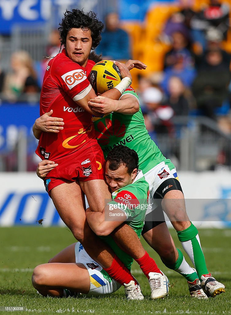 Peta Hiku of the Junior Warriors is tackled during the Toyota Cup round 26 match between the New Zealand Warriors and the Canberra Raiders at Mt Smart Stadium on September 2, 2012 in Auckland, New Zealand.