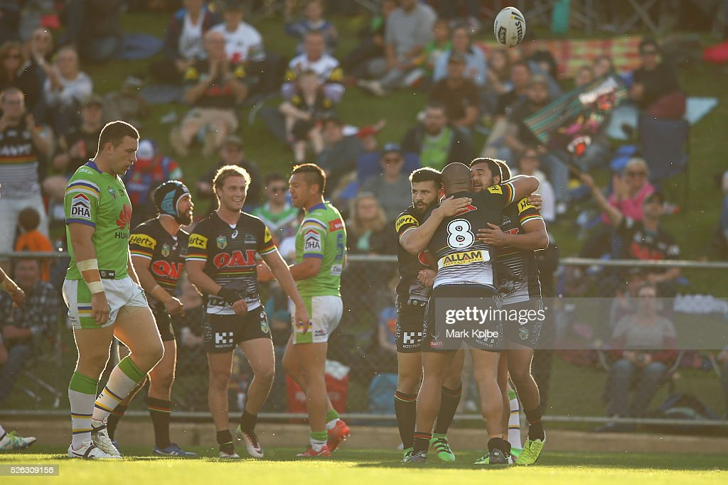 Peta Hiku of the Panthers celebrates with his team mates after scoring a try during the round nine NRL match between the Penrith Panthers and the Canberra Raiders at Carrington Park on April 30, 2016 in Bathurst, Australia.