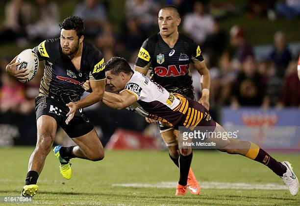 Peta Hiku of the Panthers is tackled by James Roberts of the Broncos during the round three NRL match between the Penrith Panthers and the Brisbane...
