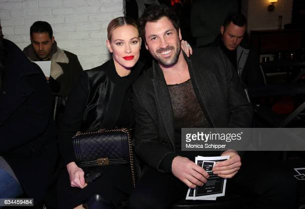 Peta Murgatroyd and Maksim Chmerkovskiy attend the VALENTINNICOLE fashion show during New York Fashion Week at Lovage on February 9 2017 in New York...