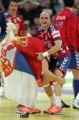 Petar Nenandic of Serbia and Ivan Nikcevic of Serbia celebrate the 2622 victory after the Men's European Handball Championship second semi final...