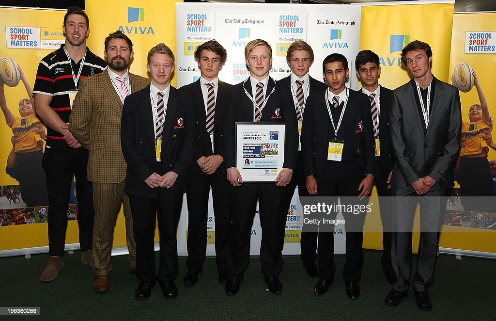 Pete Browne (L) and Paul Blake pose with School Team of the Year highly commended nominee Denstone College U15 Cricket Team during the AVIVA and Daily Telegraph School Sport Matters awards at Lord's Cricket Ground on November 14, 2012 in London, England.