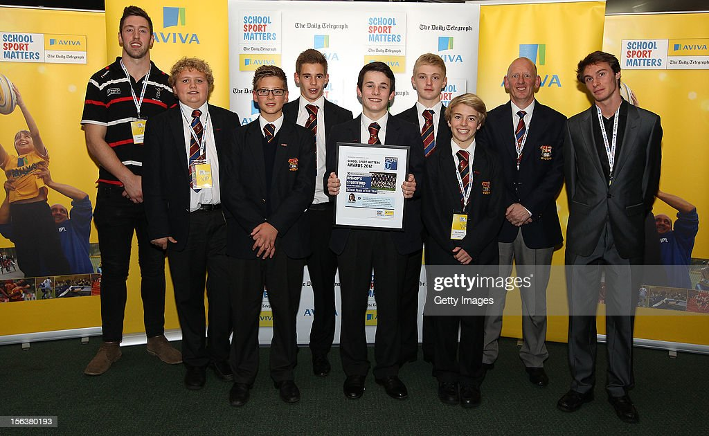 Pete Browne (L) and Paul Blake pose with School Team of the Year commended nominee Bishops Stortford College Prep School 1st XV during the AVIVA and Daily Telegraph School Sport Matters awards at Lord's Cricket Ground on November 14, 2012 in London, England.