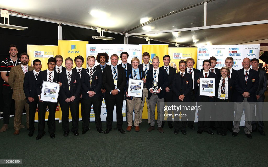 Pete Browne (L) and Paul Blake pose with School Team of the Year nominees during the AVIVA and Daily Telegraph School Sport Matters awards at Lord's Cricket Ground on November 14, 2012 in London, England.