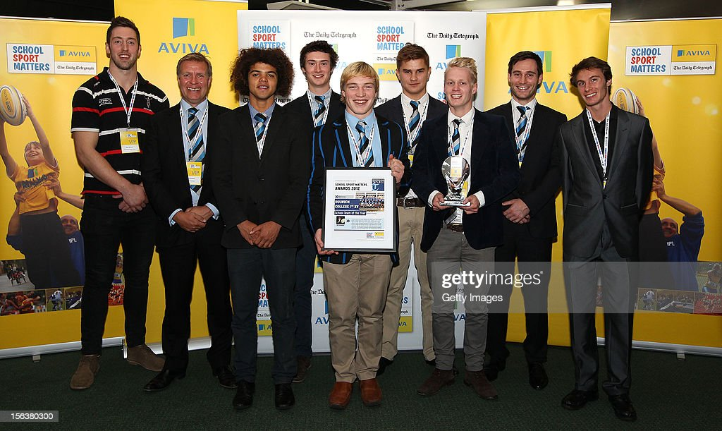 Pete Browne (L) and Paul Blake pose with School Team of the Year winners Dulwich College 1st XV during the AVIVA and Daily Telegraph School Sport Matters awards at Lord's Cricket Ground on November 14, 2012 in London, England.
