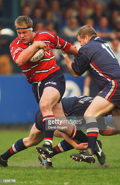 Pete Buxton of Gloucester is held by Jim Thorp of Sale during the Zurich Premiership match between Sale Sharks and Gloucester at Heywood Road on...