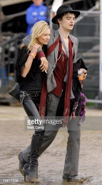 Pete Doherty and Kate Moss walk backstage the Other Stage at Worthy Farm Pilton near Glastonbury on June 23 2007 in Somerset England The festival...