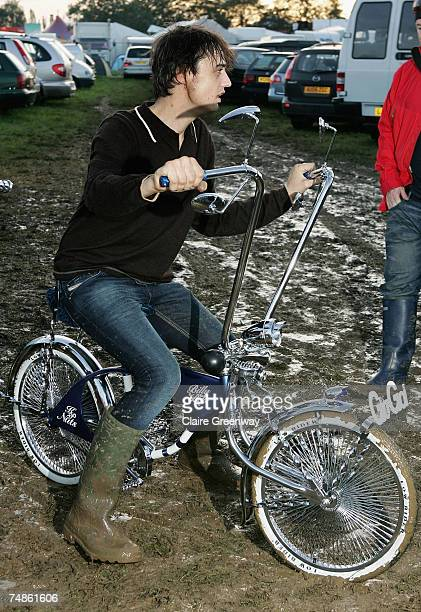 Pete Doherty rides a bicycle through mud backstage on the first day of the Glastonbury Festival at Worthy Farm Pilton near Glastonbury on June 22...