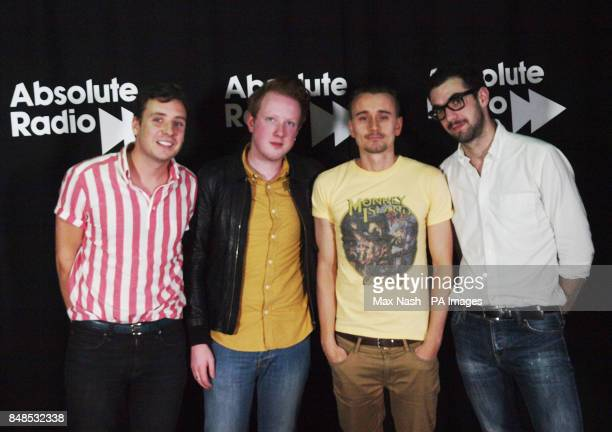 DJ Pete Donaldson with the band Two Door Cinema Club Sam Halliday lead singer Alex Trimble and Kevin Baird after their gig on Absolute Radio London...