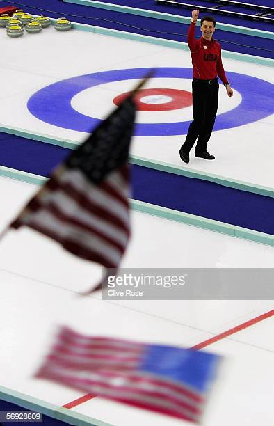 Pete Fenson of United States celebrates defeating Great Britain in the bronze medal match of the men's curling between United States and Great...