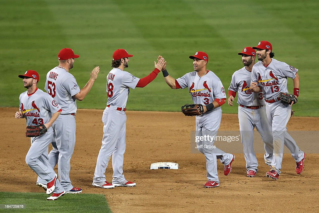 <a gi-track='captionPersonalityLinkClicked' href=/galleries/search?phrase=Pete+Kozma&family=editorial&specificpeople=6800748 ng-click='$event.stopPropagation()'>Pete Kozma</a> #38 and <a gi-track='captionPersonalityLinkClicked' href=/galleries/search?phrase=Carlos+Beltran&family=editorial&specificpeople=167108 ng-click='$event.stopPropagation()'>Carlos Beltran</a> #3 of the St. Louis Cardinals celebrate the 4-2 victory against the Los Angeles Dodgers in Game Four of the National League Championship Series at Dodger Stadium on October 15, 2013 in Los Angeles, California.