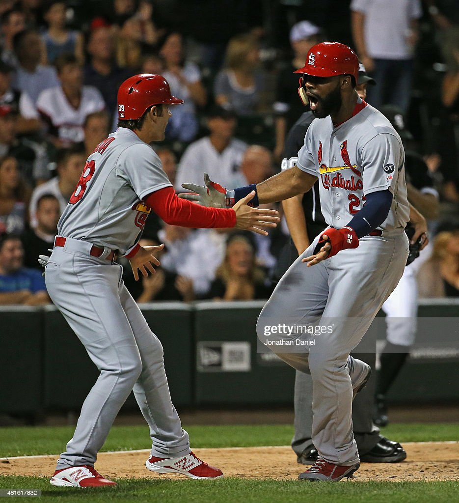Pete Kozma #38 (L) and Jason Heyward #22 of the St. Louis Cardinals celebrate scoring runs in the 8th inning against the Chicago White Sox at U.S. Cellular Field on July 22, 2015 in Chicago, Illinois.