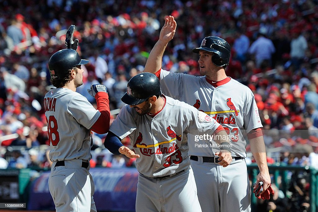 <a gi-track='captionPersonalityLinkClicked' href=/galleries/search?phrase=Pete+Kozma&family=editorial&specificpeople=6800748 ng-click='$event.stopPropagation()'>Pete Kozma</a> #38 of the St. Louis Cardinals celebrates with teammates <a gi-track='captionPersonalityLinkClicked' href=/galleries/search?phrase=Daniel+Descalso&family=editorial&specificpeople=6800752 ng-click='$event.stopPropagation()'>Daniel Descalso</a> #33 and <a gi-track='captionPersonalityLinkClicked' href=/galleries/search?phrase=David+Freese+-+Baseball+Player&family=editorial&specificpeople=4948315 ng-click='$event.stopPropagation()'>David Freese</a> #23 after hitting a three run home run in the second inning against the Washington Nationals during Game Three of the National League Division Series at Nationals Park on October 10, 2012 in Washington, DC.